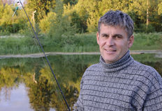 Fisherman. Smiles with a fishing rod Stock Photo
