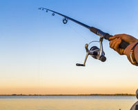 A fisherman with a fishing rod Stock Photo