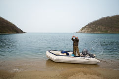 Fisherman after fishing in sea Stock Photography