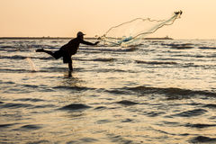 Fisherman is fishing in the sea Royalty Free Stock Photos