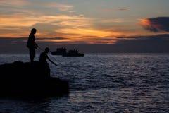 fisherman fishing at the sea Royalty Free Stock Photos