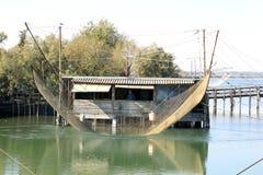 Fisherman in fishing shack, Po Delta, Italy Royalty Free Stock Images