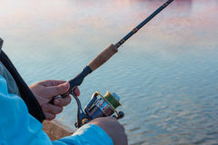 Fisherman fishing spinning Royalty Free Stock Images
