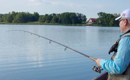 Fisherman fishing spinning Stock Photos