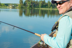 Fisherman fishing spinning Royalty Free Stock Photography