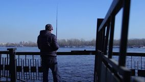 Fisherman fishing with spinning stock video
