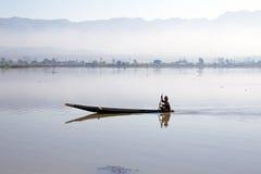 Fisherman fishing at sunrise in Myanmar Royalty Free Stock Photos