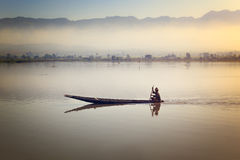 Fisherman fishing at sunrise in Myanmar. Royalty Free Stock Photography