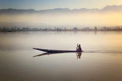 Fisherman fishing at sunrise in Myanmar. Royalty Free Stock Photography