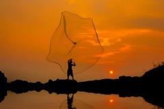 Fisherman. Fishing at sunset.Thailand Royalty Free Stock Photo