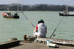 Fisherman with Fishing tackle Royalty Free Stock Images