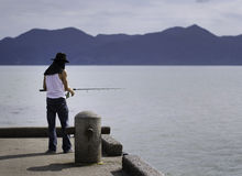 Fisherman fishing trolling in the sea Stock Image