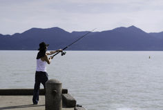 Fisherman fishing trolling in the sea Stock Photos