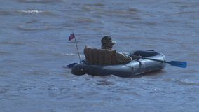 Fisherman floats on an inflatable boat. Fisherman floating on a boat on the river Ural stock video footage