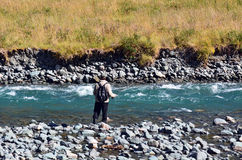 Fisherman fly fishing in Fiordland Royalty Free Stock Image