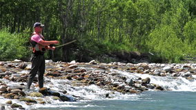 Fisherman and fly fishing. Fisherman on a mountain river