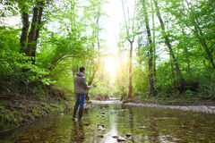 Fisherman with fly-fishing on mountain river Stock Images