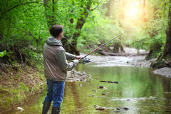 Fisherman with fly-fishing on mountain river Stock Photography