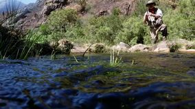 Fisherman fly fishing in river stock video footage