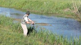 Fisherman flying fishing stock video footage
