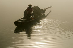 Fisherman In Foggy River Stock Photography