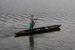 Fisherman. freshwater lake, small wooden boats. royalty free stock image