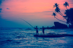 Fisherman and friend at Unawatuna beach Stock Photography