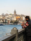 Fisherman on Galata Bridge in Eminonu neighborhood, Istanbul Stock Image