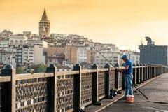 Fisherman on Galata Bridge Stock Photography