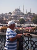 Fisherman on Galata Bridge Stock Images