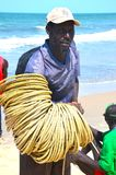 Fisherman gambia beach Royalty Free Stock Photography