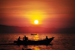 Fisherman go sailing at Pangandaran Beach, West Java. Pangandaran beach has beautiful sunrise Royalty Free Stock Photography