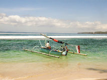 Fisherman goes fishing with his  longboat. AMED, INDONESIA - JULY 27: fisherman goes fishing with his traditional longboat made of wood and bamboo on July 27 Stock Images