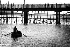 Fisherman going out to sea stock photography