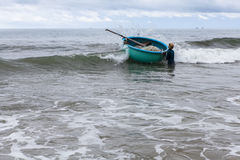 Fisherman going to sea whith his boat. Vietnam. Royalty Free Stock Photo