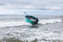 Fisherman going to sea whith his boat. Vietnam. Stock Images