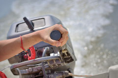Fisherman hand and boat engine Royalty Free Stock Images