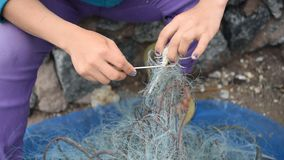 Fisherman at the harbor. Fisherman working with net at the harbor stock video