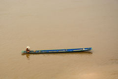 Fisherman. Has a boat on Mekong river Stock Images