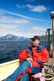 Fisherman has a rest in a break between fishing Stock Photos