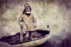 Fisherman in his boat stock image