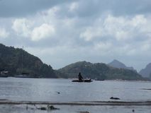 A fisherman in his boat floats in the sea for fishing. stock footage