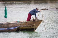 Fisherman on his boat Stock Images