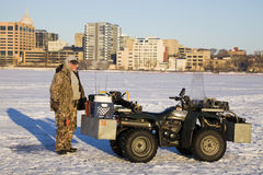 Fisherman with his quad Stock Images