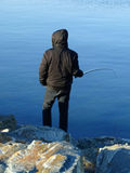 Fisherman hobby winter cold ocean Royalty Free Stock Photos