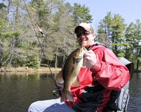 Fisherman holding a Bass royalty free stock images