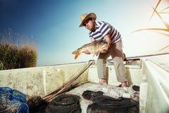 Fisherman holding a big carp Stock Photo