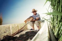 Fisherman holding a big carp Royalty Free Stock Photos