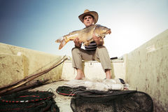 Fisherman holding a big carp Stock Image