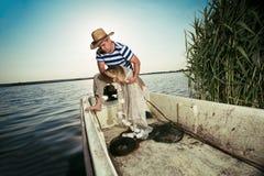 Fisherman holding a big carp Royalty Free Stock Photo